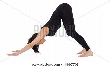 woman stand in yoga asana - Downward Facing Dog