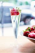 Dish With Strawberries And Champagne Glasses On The Table. poster