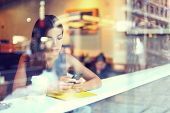 Cafe city lifestyle woman on phone drinking coffee texting text message on smartphone app sitting in poster