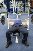 stock photo of weight-lifting  - man training with gym weights - JPG