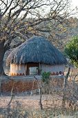 Traditional rondavele African house in a village near Kalahari desert.