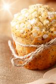 foto of bakeshop  - poppy seed muffin in rustic style with sun beam - JPG