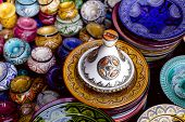 stock photo of tagine  -  decorated tagine and traditional morocco souvenirs in medina souk - JPG