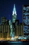 stock photo of new york skyline  - Midtown Manhattan skyline at Night - JPG