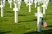 White crosses in American Cemetery, Coleville-sur-Mer, Omaha Beach, Normandy, France. poster