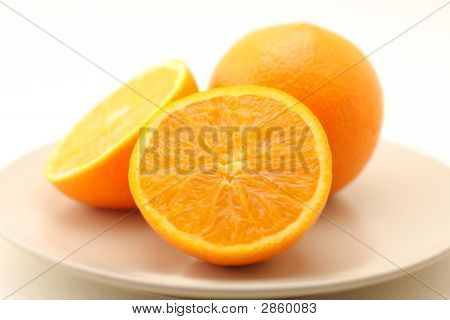 Oranges On Plate Isolated On White Background