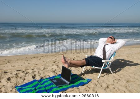Businessman On Beach With Laptop