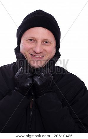 Man With Gloves And A Cap Is Smiling