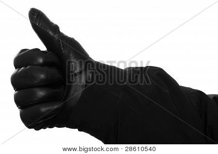 Hand With Glove Is Holding Up The Thumb
