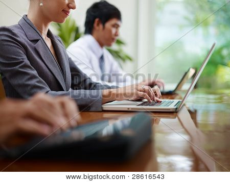 Business Man And Women Typing On Pc During Meeting