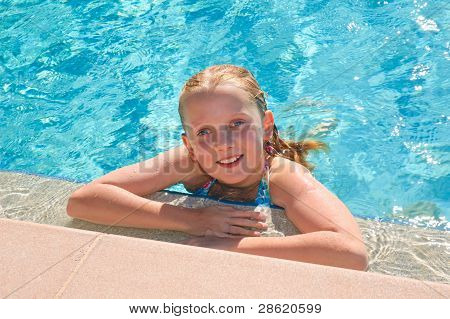 teen girl enjoying in pool