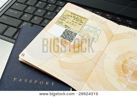 open passport and laptop