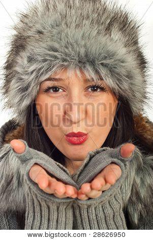 Beauty Winter Woman Blowing
