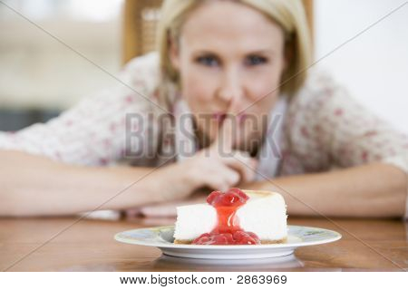 Woman Tempted By Strawberry Cheesecake