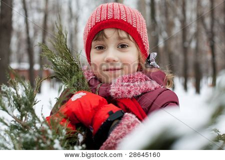 Little Girl In A Knitted Hat