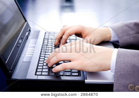 Businessman'S Typing On A Notebook Keyboard