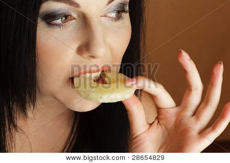 Woman Bitting Pineapple