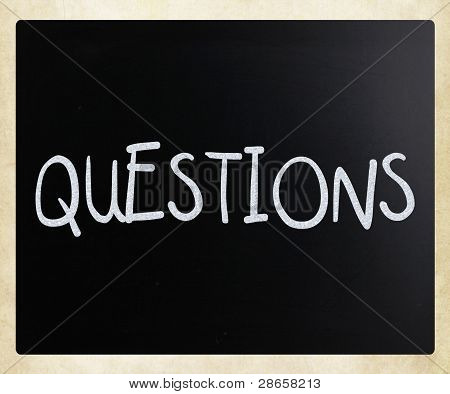"The Word ""questions"" Handwritten With White Chalk On A Blackboard"