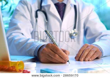 Doctor Writing Prescription
