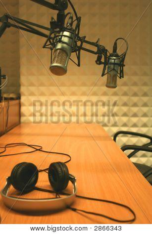 Microphones And Headphones In A Studio