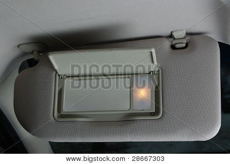 Sun visor mirror in a car