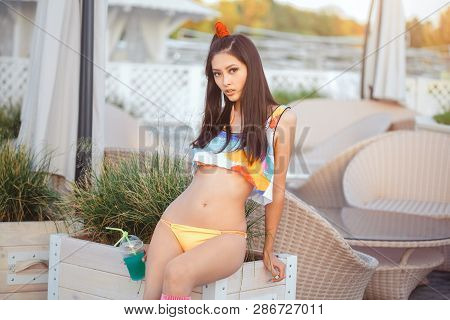 Young Asian Fashion Woman Drinking