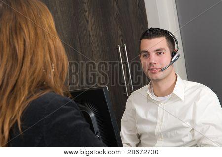 Customer At A Service Desk