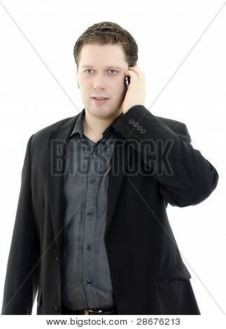 Portrait Of A Handsome Young Business Man Talking On Mobile Phone. Isolated On White Background With
