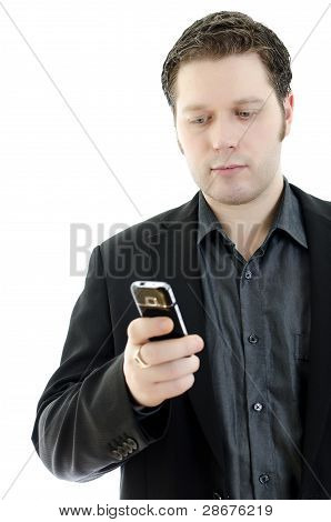 Portrait Of A Handsome Young Business Man Using Mobile Phone. Isolated On White Background With Copy