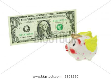 Flying Piggy Bank Passing A Dollar Bill