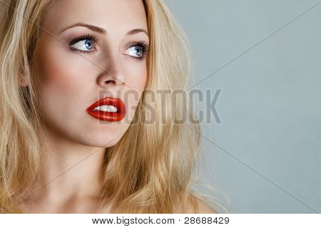 Young Blond Woman Looking Up