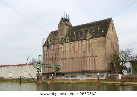 Old Industrial Storage Building At River Weser In Germany