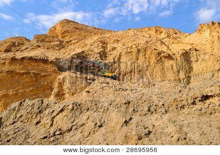 Excavator On The Rocks
