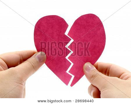 Broken pink heart on hand