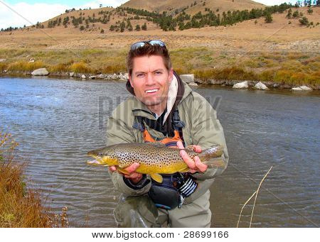 Fly Fishing - Fisherman Holding Fish, Brown Trout
