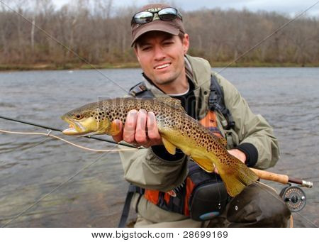 Fly Fishing - Fisherman Holding Fish