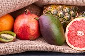 Fresh Exotic Fruits Close Up. Assorted Tropical Fruits And Sackcloth. Sumer Healthy Fruits. poster