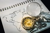 Gold Pocket Watch And World Globe Crystal Glass On World Map Outline Sketch On Paper Page Of Noteboo poster