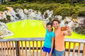 New Zealand tourist attraction couple tourists taking selfie travel destination, Waiotapu. Active ge poster
