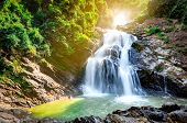 Beautiful Waterfall At The Mountain With Blue Sky And White Cumulus Clouds. Waterfall In Tropical Gr poster