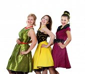 image of parti poodle  - three stylish young woman in bright colour dresses - JPG