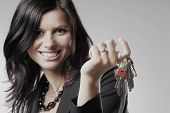 picture of car key  - A young woman in black suit with car keys - JPG