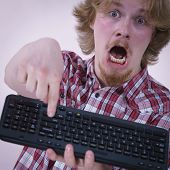 Nerd Geek Young Adult Man Playing Video Games Holding Computer Keyboard. Being Addicted To Gaming Co poster
