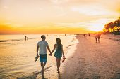 Beach summer beach people lifestyle happy couple enjoying sunset walk on Shelling beach famous touri poster