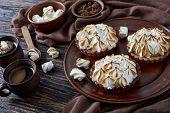 Close-up Of Lemon Meringue Chocolate Mini Pies With Browned Meringue Peaks Served With Coffee, Mini  poster