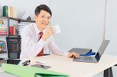 Portrait Of Middle Aged, Handsome, Asian, Businessman, In White Shirt, Dark Red Necktie, Working In  poster