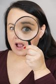 Adult Woman With Magnifying Glss poster