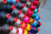 Colorful Embroidery Thread Spool Using In Garment Industry, Row poster