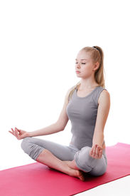 picture of yoga mat  - Young woman doing yoga relaxing sitting on pink gymnastics mat - JPG