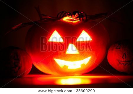 Photo of terrible pumpkin with grin on a black background